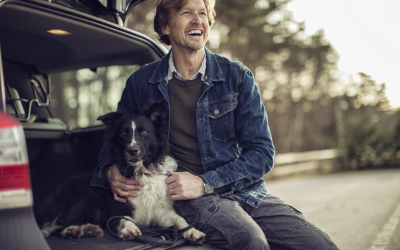 Guy With Dog In Car